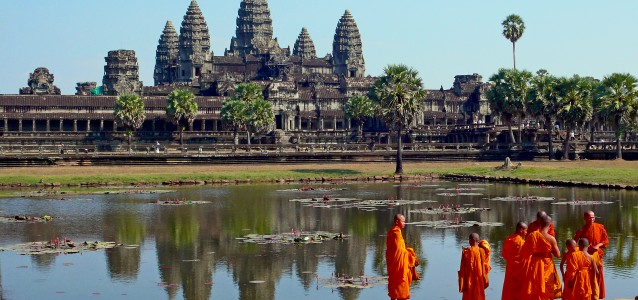 Buddhist monks stand outside Angkor Wat, Cambodia