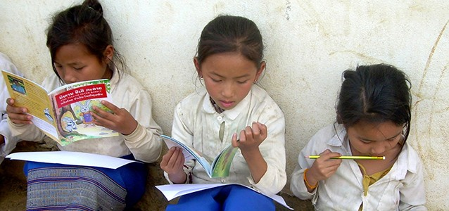 Lao schoolgirls reading books
