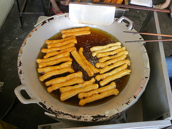 Famous Fritters cooking in oil - Penang